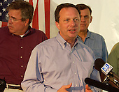 Milton, Florida - July 7, 2005 --  Undersecretary Michael D. Brown, Director of the United States Federal Emergency Management Agency (FEMA),  addresses a press conference. Governor Jeb Bush of Florida,left, and United States Senator Senator Mel Martinez (Republican of Florida), right, look on.  <br /> Credit: Leif Skoogfors - FEMA via CNP