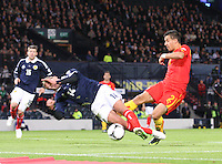 Jordan Rhodes falls under pressure from Daniel Georgievski in the Scotland v Macedonia FIFA World Cup Qualifying match at Hampden Park, Glasgow on 11.9.12.