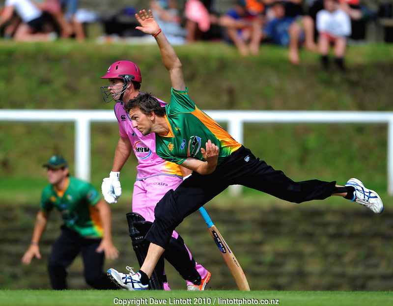 Central's Michael Mason bowls pass Brad Wilson. HRV Cup Twenty20 cricket - Central Stags v Northern Knights at Pukekura Park, New Plymouth, New Zealand on Thursday, 23 December 2010. Photo: Dave Lintott / lintottphoto.co.nz