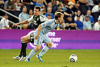 Seth Sinovic (16) defender Sporting KC turns Kenny Cooper (33) forward Portland Timbers..... Sporting Kansas City defeated Portland Timbers 3-1 at LIVESTRONG Sporting Park, Kansas City, Kansas.