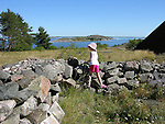 Child Climbing on Stonewall on Island of Kökar, Åland, Finland