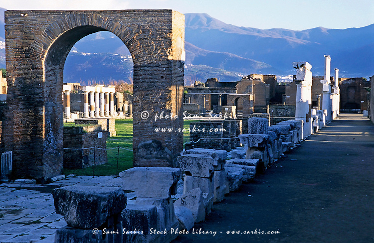 A perfectly preserved arch amongst old ruins, Pompeii, Italy.