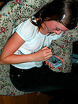 Young girl using electronic game