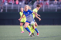 Allston, MA - Sunday, April 24, 2016: Boston Breakers midfielder Kristie Mewis (19) and Seattle Reign FC midfielder Keelin Winters (11). The Boston Breakers play Seattle Reign during a regular season NSWL match at Harvard University.