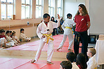 Albany CA Boy around eleven-years-old demonstrating moves in Tae Quan Do performance for parents