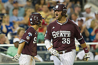 Mississippi State first baseman Wes Rea (35) celebrates with teammate Adam Fraizer (12) after he scores against the Indiana Hoosiers during Game 6 of the 2013 Men's College World Series on June 17, 2013 at TD Ameritrade Park in Omaha, Nebraska. The Bulldogs defeated Hoosiers 5-4. (Andrew Woolley/Four Seam Images)