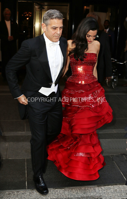 WWW.ACEPIXS.COM<br /> <br /> May 4 2015, New York City<br /> <br /> George Clooney and Amal Clooney leaving the Carlyle Hotel on the way to the Met Gala on May 4 2015 in New York City<br /> <br /> By Line: Zelig Shaul/ACE Pictures<br /> <br /> <br /> ACE Pictures, Inc.<br /> tel: 646 769 0430<br /> Email: info@acepixs.com<br /> www.acepixs.com