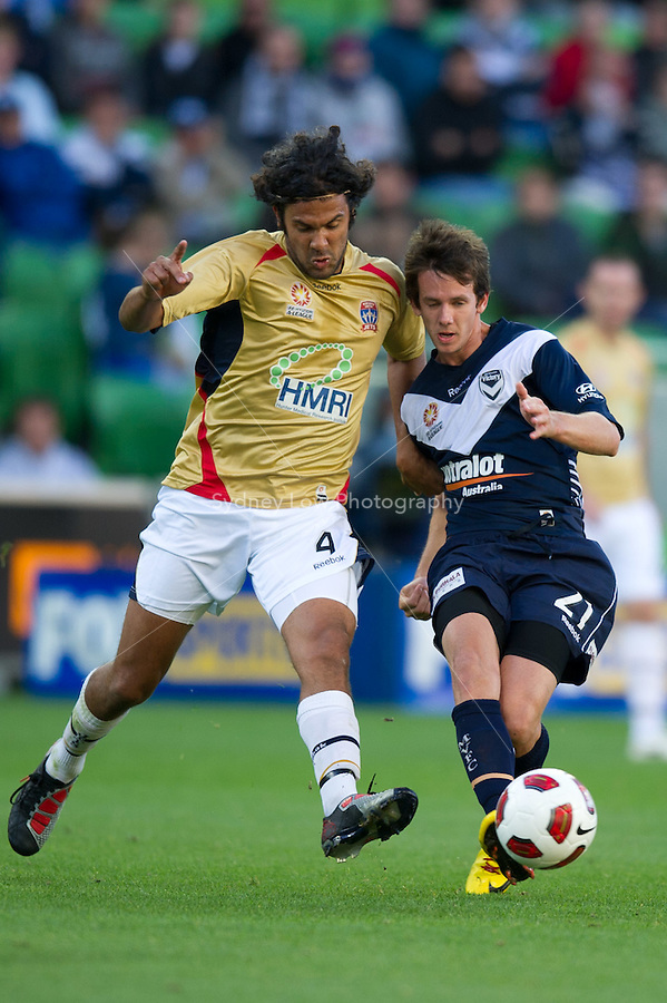 MELBOURNE, AUSTRALIA - DECEMBER 27: Robbie Kruse of the Victory kicks the ball ahead of Nikolai Topor-Stanley of the Jets during the round 20 A-League match between the Melbourne Victory and the Newcastle Jets at AAMI Park on December 27, 2010 in Melbourne, Australia. (Photo by Sydney Low / Asterisk Images)