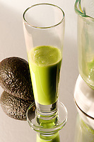 Avocado milkshake with an avocado and a blender