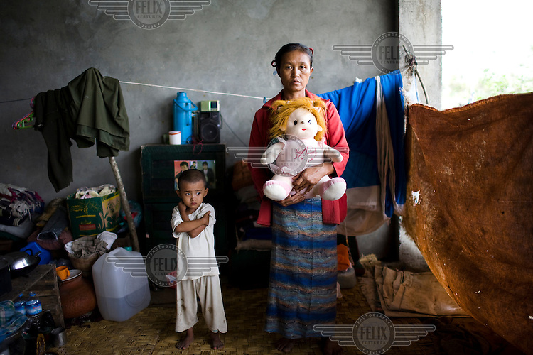 """When Cyclone Nargis hit the Irrawaddy Delta on 02/05/2008, all 54 year old Daw Hlamyint could carry was her three year old granddaughter, Su Su Khing, and the child's teddy bear. """"Su Su is very close to me and wouldn't spend any time away frfom either me or her teddy bear, Pont Pont."""". They live alongside other refugees from the 7th ward, Hlaingthaya township in Rangoon (Yangon), in the Shwe Than Lwin shopping complex, which is under construction and has acted as a small refugee centre."""