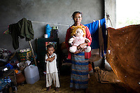 "When Cyclone Nargis hit the Irrawaddy Delta on 02/05/2008, all 54 year old Daw Hlamyint could carry was her three year old granddaughter, Su Su Khing, and the child's teddy bear. ""Su Su is very close to me and wouldn't spend any time away frfom either me or her teddy bear, Pont Pont."". They live alongside other refugees from the 7th ward, Hlaingthaya township in Rangoon (Yangon), in the Shwe Than Lwin shopping complex, which is under construction and has acted as a small refugee centre."
