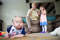Fred Bermont and daughter Elyse Bermont (age 2.5, right) eat before he drops the kids off at day-care in Lexington, Massachusetts, USA, before he goes to work on June 9, 2014. Bermont is the father of two children and shares parenting duties with his wife, Jen Bermont. Fred usually takes care of the morning routine, including feeding, dressing, and dropping the kids off at day-care, and Jen picks them up and watches over them in the afternoon. Fred is a Senior Clinical Standards Specialist at Shire, a pharmaceutical company with headquarters in Lexington.