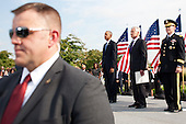 United States President Barack Obama stands during a ceremony at the Pentagon to mark the 13th anniversary of the September 11th, 2001 terrorist attacks, in Washington, Thursday, September 11, 2014. Shown with the president are U.S. Secretary of Defense Chuck Hagel (center) and the Chairman of the Joint Chiefs of Staff, General Martin E.  Dempsey, U.S. Army.<br /> Credit: Martin Simon / Pool via CNP
