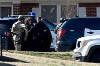 NWA Democrat-Gazette/DAVID GOTTSCHALK Members of law enforcement take Dekota Harvey, 22, into custody Friday, March 15, 2019  around 10;30 a.m. at the Applegate Apartment complex in Springdale. Fayetteville police said Harvey, 22, was wanted in connection with a Thursday night shooting that left one person dead and a second hospitalized. The shooting happened in the 900 block of North Leverett Avenue, according to police. Officers were called to a report of a disturbance in the area at 9:12 p.m. An ambulance was dispatched to the area at 9:16 p.m.