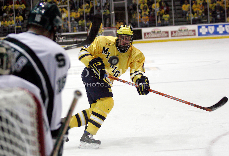 4 November 2006: Michigan sophomore defender Jack Johnson (3) has a shot deflected off of Michigan State defender Tyler Howells (16) during a CCHA conference ice hockey game between Michigan and in-state rival Michigan State, at Yost Ice Arena in Ann Arbor, MI. Michigan won the game 6-2.