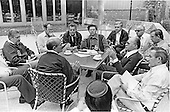Prime Minister Menachem Begin of Israel, briefs members of the Israeli delegation on the porch of Laurel Lodge at Camp David, the United States presidential retreat near Thurmont, Maryland to discuss the summit with President Anwar Sadat of Egypt (not pictured) and U.S. President Jimmy Carter (not pictured) on September 2, 1978.  visible in the photo are Foreign Minister Moshe Dayan of Israel, bottom left center, and Defense Minister Ezer Weizman, left..Credit: White House via CNP