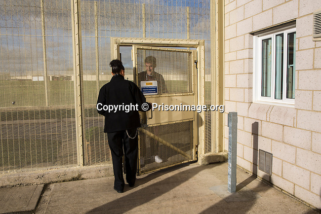 A prisoner is let back onto his wing by a prison officer. HMP/YOI Portland, Dorset. A resettlement prison with a capacity for 530 prisoners. © prisonimage.org.  Any image use must be agreed first. All images must be credited.