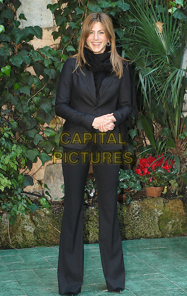 JENNIFER ANISTON.Along Came Polly photocall in Rome.16 February 2004.full length, full-length, black trouser suit.www.capitalpictures.com.sales@capitalpictures.com.© Capital Pictures.