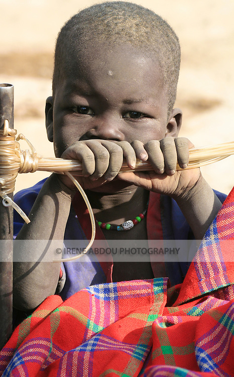 "A boy grows up in a dusty cattle camp near Akot, South Sudan.  The Dinka are traditionally ""cattle keepers,"" living in cattle camps with hundreds or even thousands of cows."
