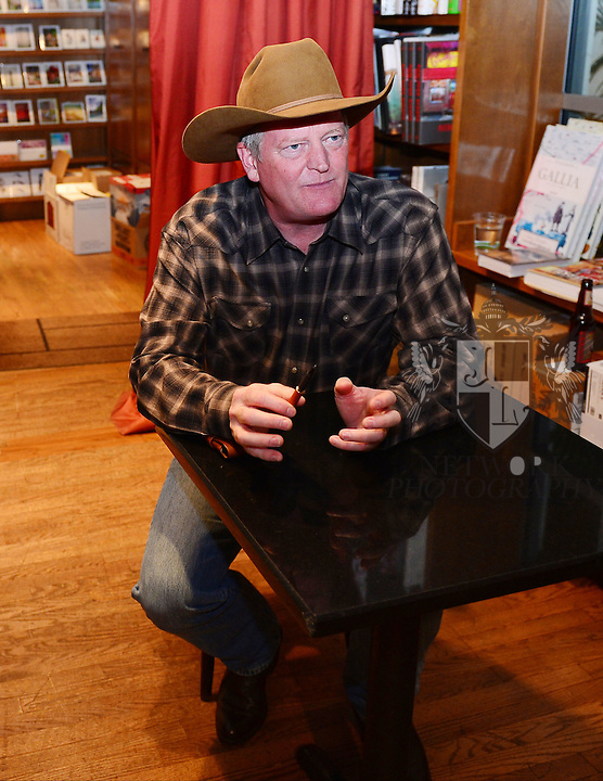 CORAL GABLES, FL - OCTOBER 21: Author Craig Johnson signs copies of 'Spirit of Steamboat: A Walt Longmire Story' at Books and Books on October 21, 2013 in Coral Gables, Florida. (Photo by Johnny Louis/jlnphotography.com)