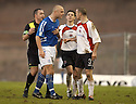 14/01/2006         Copyright Pic: James Stewart.File Name : sct_jspa18_clyde_v_stjohnstone.REFEREE BRIAN WINTER STEPS IN AS SIMON MENSING AND EDDIE MALONE SQUARE UP TO EACH OTHER..Payments to :.James Stewart Photo Agency 19 Carronlea Drive, Falkirk. FK2 8DN      Vat Reg No. 607 6932 25.Office     : +44 (0)1324 570906     .Mobile   : +44 (0)7721 416997.Fax         : +44 (0)1324 570906.E-mail  :  jim@jspa.co.uk.If you require further information then contact Jim Stewart on any of the numbers above.........