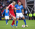 Aberdeen v St Johnstone....01.02.14   League Cup Semi-Final<br /> Chris Iwelumo and Andrew Considine<br /> Picture by Graeme Hart.<br /> Copyright Perthshire Picture Agency<br /> Tel: 01738 623350  Mobile: 07990 594431