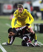 FUSSBALL   1. BUNDESLIGA  SAISON 2011/2012   20. Spieltag 1. FC Nuernberg - Borussia Dortmund         03.02.2012 Sven Bender (oben, Borussia Dortmund) muss nach diesem Foul von Daniel Didavi  (1 FC Nuernberg) verletzt ausgewechselt werden