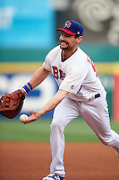 Buffalo Bisons first baseman Casey Kotchman (55) flips the ball to the pitcher covering first during a game against the Lehigh Valley IronPigs on July 9, 2016 at Coca-Cola Field in Buffalo, New York.  Lehigh Valley defeated Buffalo 9-1 in a rain shortened game.  (Mike Janes/Four Seam Images)