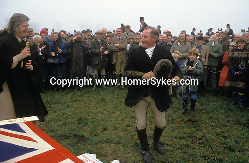 The Wessex Yeomanary race before the hunt starts. The Duke of Beaufort Hunt, Badminton Estate Gloucestershire. This is local farmers race. Lady Caroline Jane Thynne, the first wife of the Duke of Beaufort gives out the prize bottle of Champagne. The English Season published by Pavilon Books 1987. Lady Caroline died in 1995 of cancer.