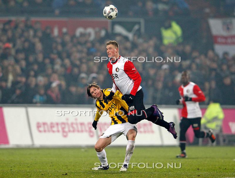 Nederland, Rotterdam, 12 februari 2011.Eredivisie .Seizoen 2011-2012.Feyenoord-Vitesse (3-1).John Guidetti van Feyenoord wint het kopduel van Tomas Kalas van Vitesse