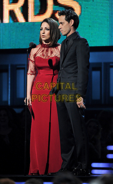LOS ANGELES, CA - JANUARY 26 : (L-R) Gloria Estefan and Marc Anthony speak onstage at The 56th Annual GRAMMY Awards at Staples Center on January 26, 2014 in Los Angeles, California.<br /> CAP/MPI/PG<br /> &copy;PGFMicelotta/MediaPunch/Capital Pictures