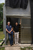 57 year old Frédéric Viala, president and 47 year old Franck Ducharne (right) of Entofood, (the pilot project involving maggot production) poses in front of the greenhouse in village Kundang, at the outskirts of capital Kuala Lumpur, Malaysia.