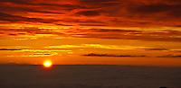 Sunrise above the clouds at 9,745 feet in Haleakala National Park, Maui.