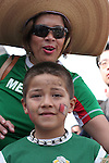 09 June 2006: A young Mexico fan with his mother on their way to the game. Germany played Costa Rica at the Allianz Arena in Munich, Germany in the opening match, a Group A first round game, of the 2006 FIFA World Cup.
