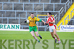 Aidan O'Mahony Rathmore tackles John Paul Brosnan Gneeveguilla during their O'Donoghue cup semi final in Fitzgerald Stadium on Sunday
