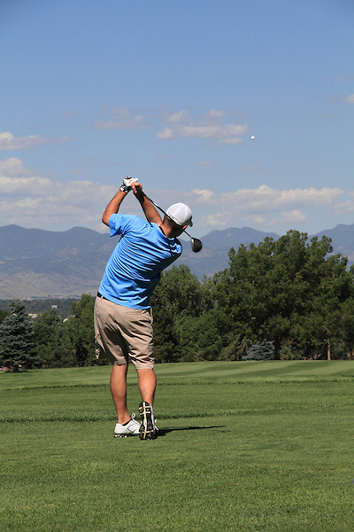 Caucasian man teeing-off at City Park Golf Course, Denver, Colorado, USA