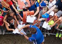 19-06-13, Netherlands, Rosmalen,  Autotron, Tennis, Topshelf Open 2013, Stanislas signing autographs<br /> Photo: Henk Koster