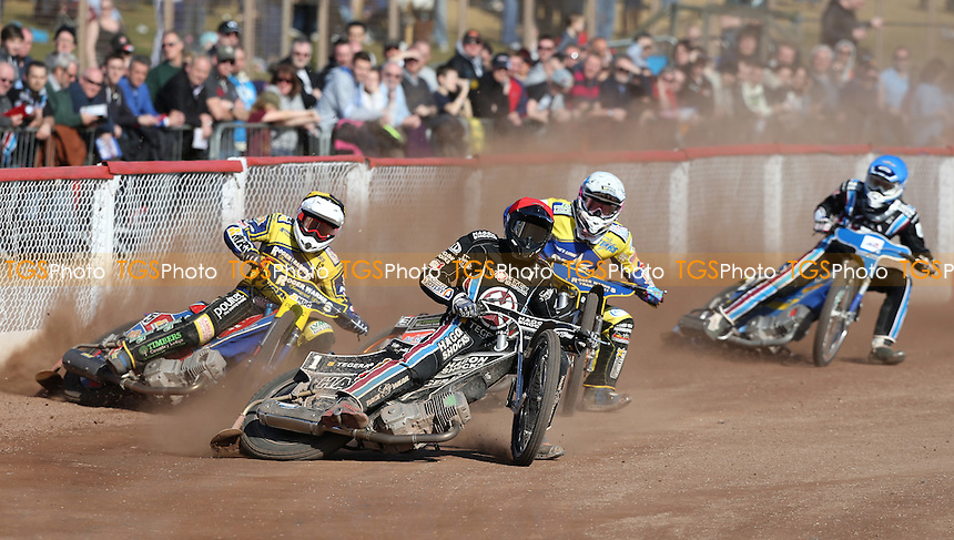 A good crowd watches Andreas Jonsson (red), Robert Lambert (yellow), Rory Schlein (white) and Piotr Swiderski (blue) in heat 11 during Lakeside Hammers vs King's Lynn Stars, Elite League Speedway at the Arena Essex Raceway on 25th March 2016
