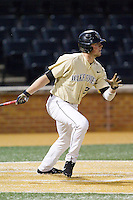 Charlie Morgan (24) of the Wake Forest Demon Deacons follows through on his swing against the Cincinnati Bearcats at Wake Forest Baseball Park on February 21, 2014 in Winston-Salem, North Carolina.  The Bearcats defeated the Demon Deacons 5-0.  (Brian Westerholt/Four Seam Images)