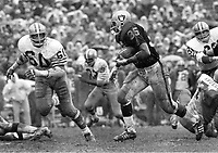 Raidersvs 49ers..Hewritt Dixon running #60 Roland Lakes. (.1969 photo/Ron Riesterer)