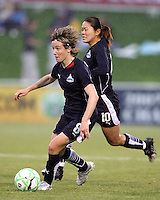 Sonia Bompastor #8 and Homare Sawa #10 of the Washington Freedom start an attack during a WPS match against St' Louis Athletica at the Maryland Soccerplex on May 3, 2009 in Boyds Maryland. The game ended in a 3-3 tie.