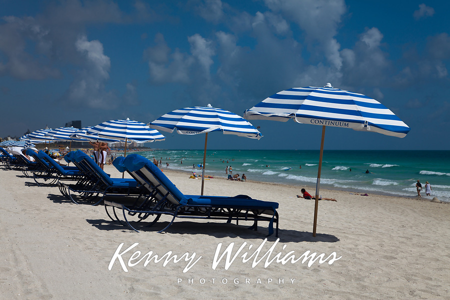 Blue Beach Umbrellas and Sun Lounge Chairs, White Sand Beach, South Beach, Miami, Florida, FL, Amercia, USA.