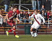 Virginia Tech midfielder Robert Alberti (6) brings the ball forward as Boston College defender Matt Wendelken (8) closes.Boston College (maroon) defeated Virginia Tech (Virginia Polytechnic Institute and State University) (white), 3-1, at Newton Campus Field, on November 3, 2013.