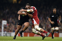 Charlie Faumuina of New Zealand is tackled. Rugby World Cup Pool C match between New Zealand and Georgia on October 2, 2015 at the Millennium Stadium in Cardiff, Wales. Photo by: Patrick Khachfe / Onside Images
