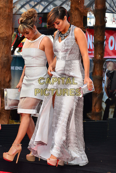 "Vanessa White, Frankie Sandford from The Saturdays .The European Premiere of ""The Hangover Part 3"", Empire Leicester Square, London, England..22nd May 2013.full length white sheer pregnant clutch bag band group grey gray snakeskin print top sleeveless  walking looking down side profile .CAP/BF.©Bob Fidgeon/Capital Pictures"