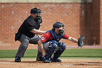 NJIT Highlanders catcher Brady Hall (14) sets a target as home plate umpire Kevin Morgan looks on during the game against the High Point Panthers at Williard Stadium on February 18, 2017 in High Point, North Carolina. The Panthers defeated the Highlanders 11-0 in game one of a double-header. (Brian Westerholt/Four Seam Images)