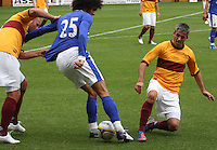 Marouane Fellaini beats the combined effort of Michael Higdon and Keith lasley in the Motherwell v Everton friendly match at Fir Park, Motherwell on 21.7.12 for Steven Hammell's Testimonial.