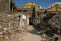 Building surrounded by rubble from demolished buildings, Shanghai, China
