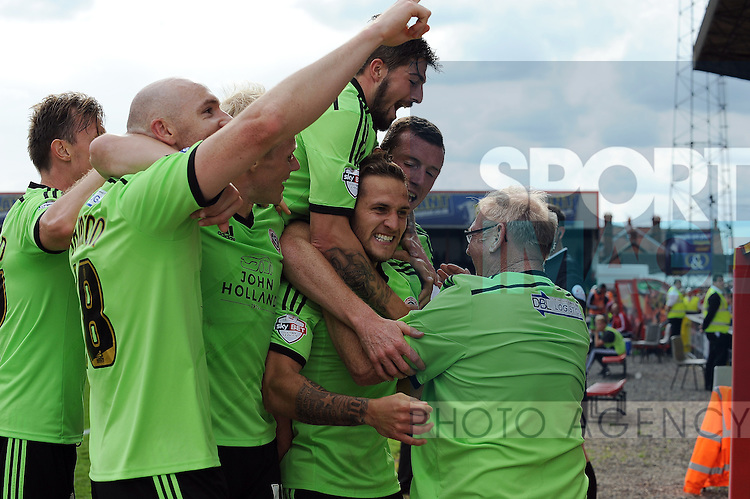 Billy Sharp of Sheffield United celebrates scoring his goal to make it 2-0 with a Sheffield United supporter (right)<br /> - Sky Bet League One - Swindon Town vs Sheffield United - The County Ground - Swindon - England - 29th August 2015 <br /> --------------------