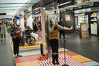 """Hannah Florence, performing in Cirque du Soleil's Broadway musical """"Paramour"""", sings songs from the musical at a lunchtime performance in Turnstyle, a shopping and foodie arcade in the subway in New York Tuesday, November, 29, 2016. """"Paramour"""" is at the Lyric Theatre and is about the golden age of Hollywood. (© Richard B. Levine)"""